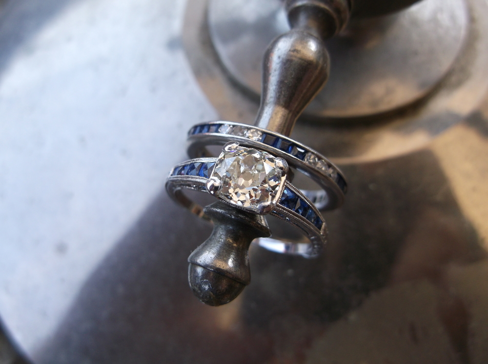 SOLD (band is still available) - Gorgeous 0.98 carat Old Mine cut diamond set in a beautiful sapphire and white gold setting. Pictured here paired with our diamond and sapphire eternity band.