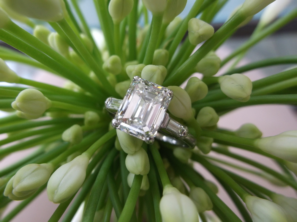 SOLD - Absolutely breath taking 3.02 carat emerald cut diamond set in a dainty platinum mounting with baguette diamond detail.