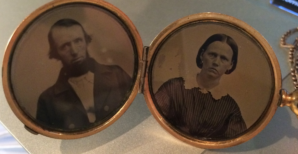 Victorian Era gold locket featuring pictures of great grand parents.