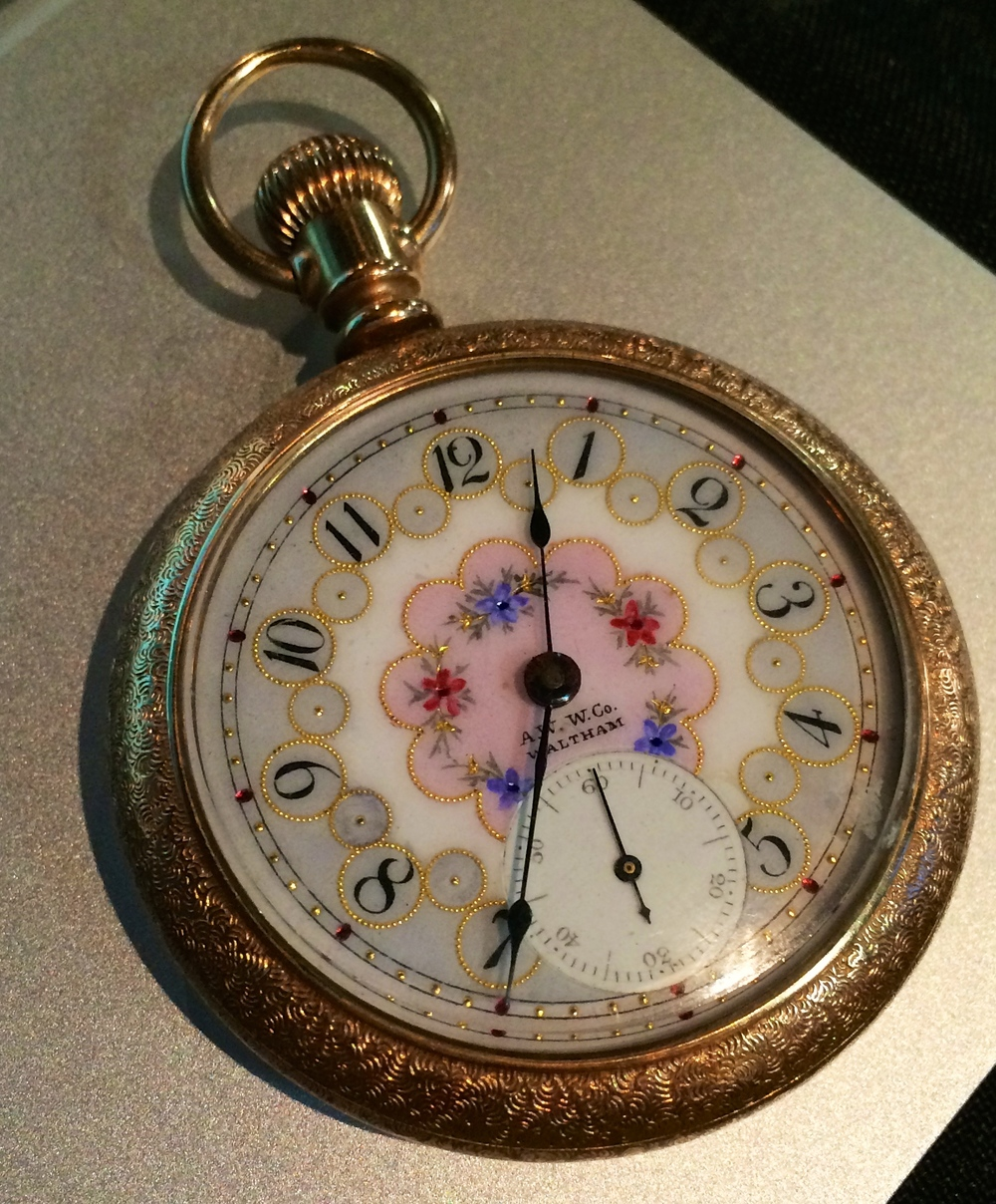 Turn of the century pocket watch with a beautifully detailed face.