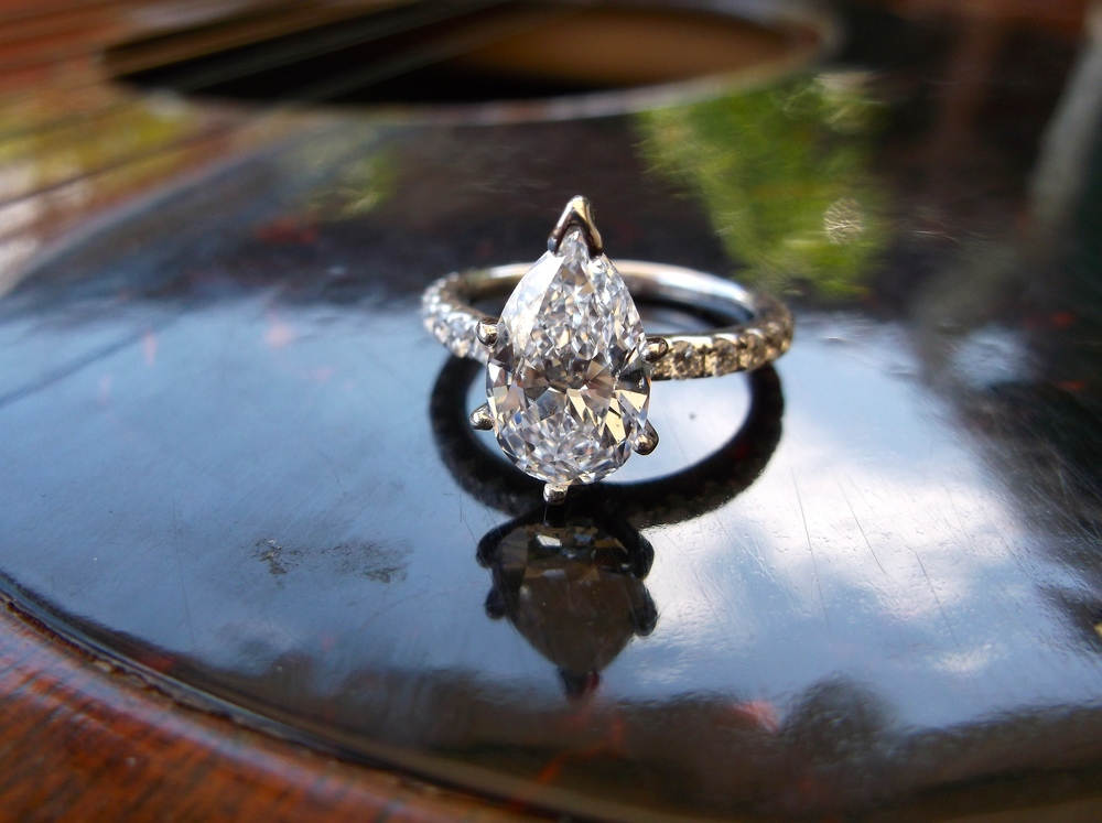 SOLD - Divine 2.04 carat pear shaped diamond set in a dainty diamond and white gold mounting.