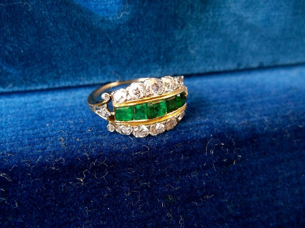 Edwardian era Old European cut diamond and emerald ring set in platinum on yellow gold.
