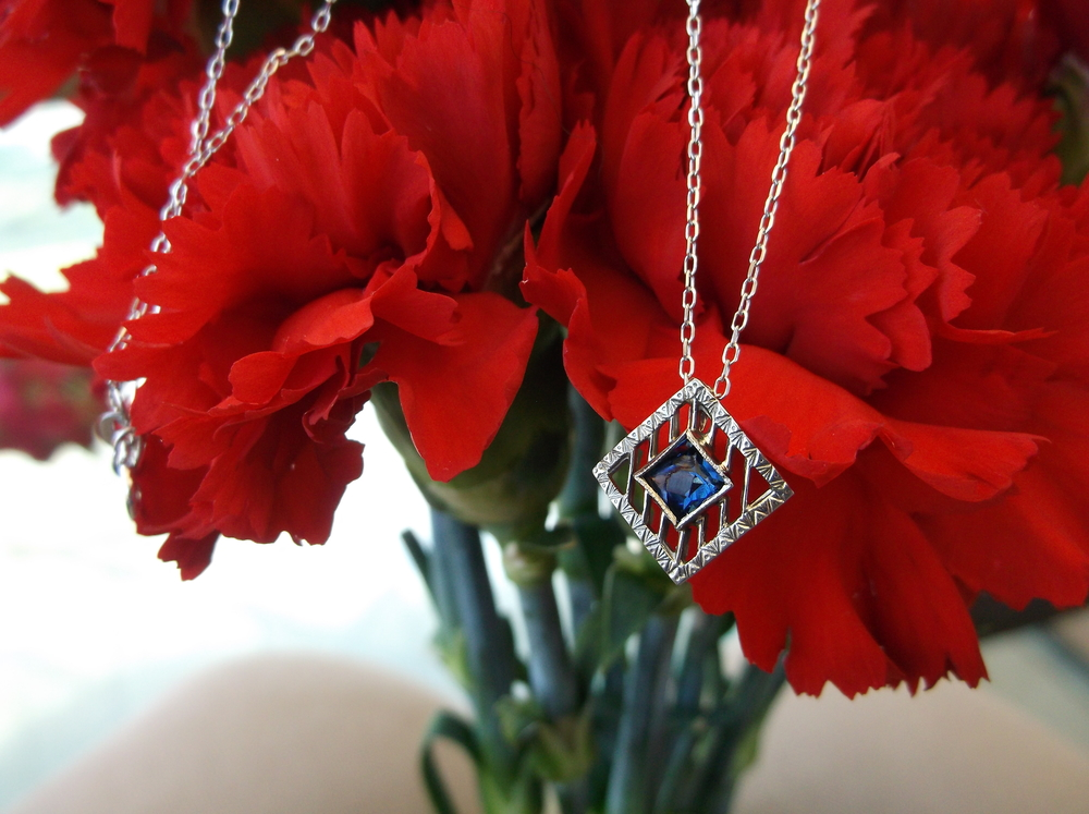 For July: Art Deco sapphire and white gold pendant.
