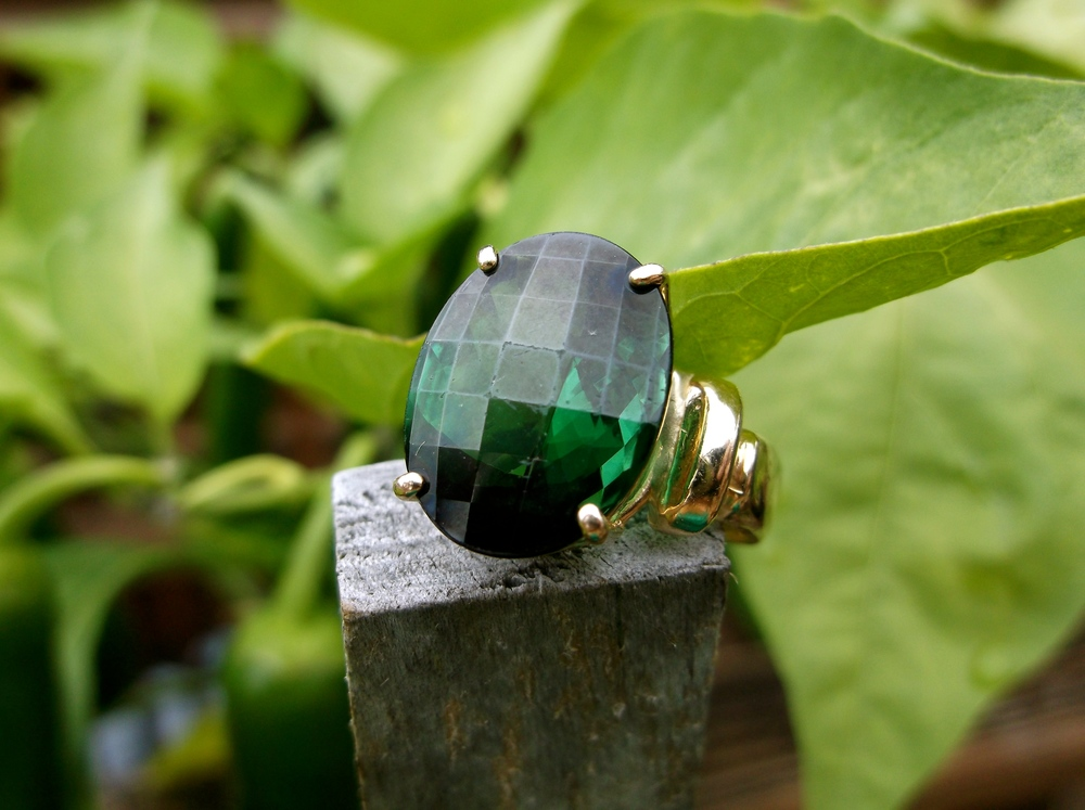 SOLD - Striking 8.0 carat green tourmaline set in a classic yellow gold mounting.