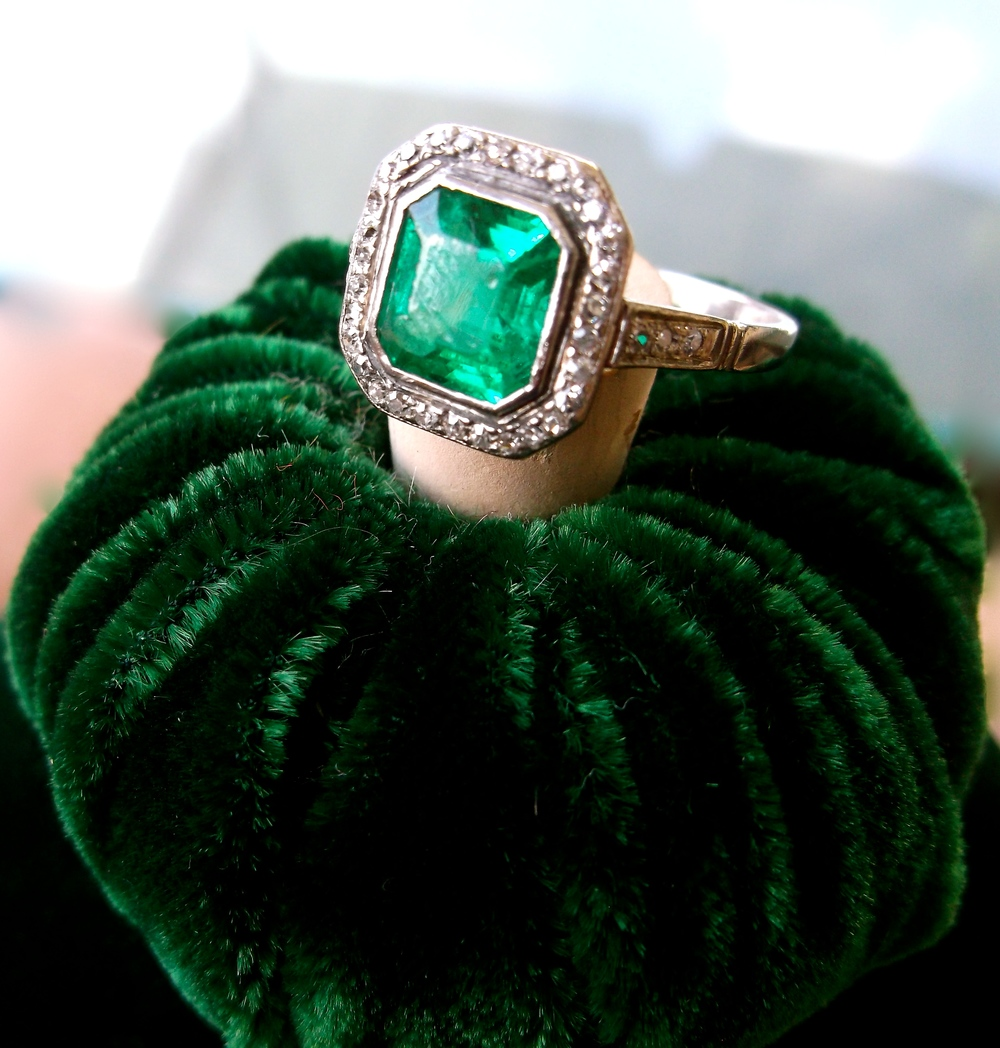 SOLD - Striking 1920's 1.25 carat emerald ring with 0.20 carats total weight in diamonds set in platinum.