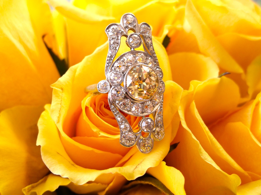 SOLD - Divine Edwardian Era (1910-1914) 1.80 carat Fancy Yellow Old European cut diamond ring surrounded by 1.72 carats total weight in Old European cut diamonds set in platinum.