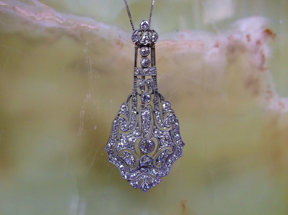 "SOLD - Exquisite Art Deco diamond and platinum pendant with 2.70 carats total weight in Old European cut and single cut diamonds. (Approximately 2.0"" in length.)"