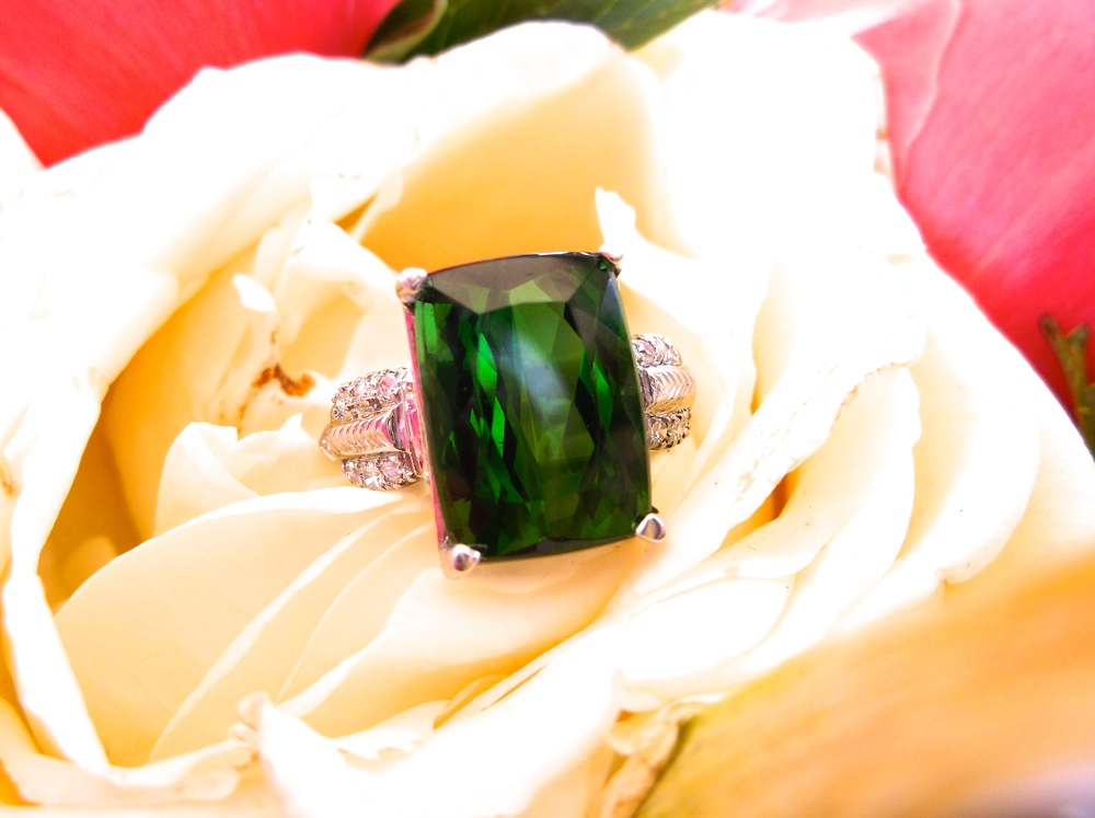 SOLD - Beautiful 10.96 carat green tourmaline set in a platinum and diamond detail mounting.