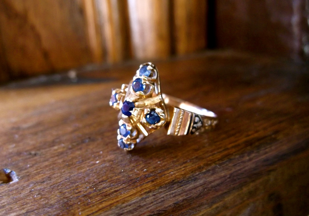 SOLD - Beautiful Victorian era sapphire and yellow gold ring with lovely hand engraving and black enameling detail.