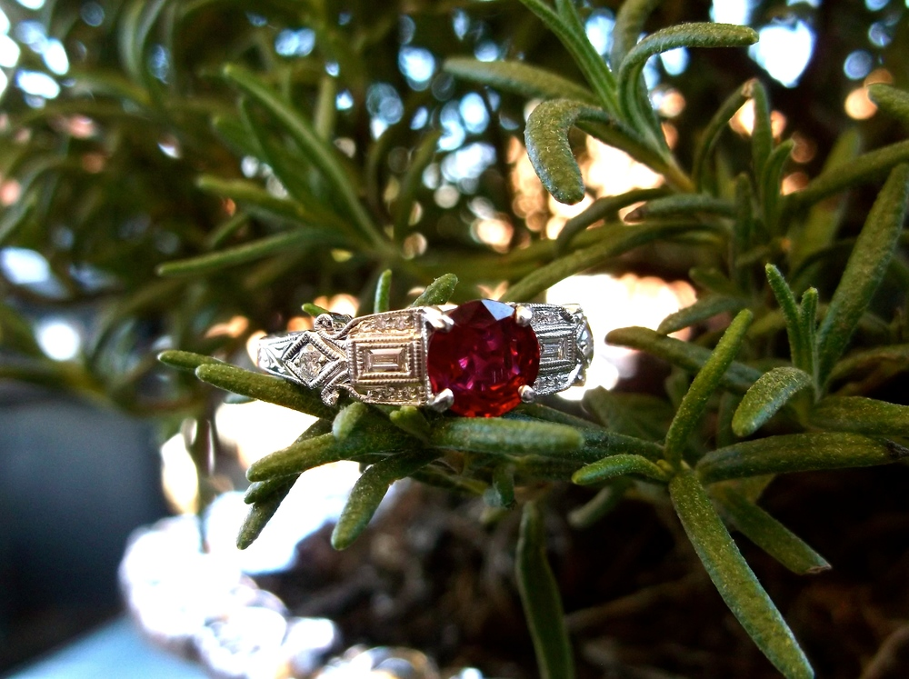 SOLD - Vibrant 0.79 carat ruby set in a diamond and white gold mounting.