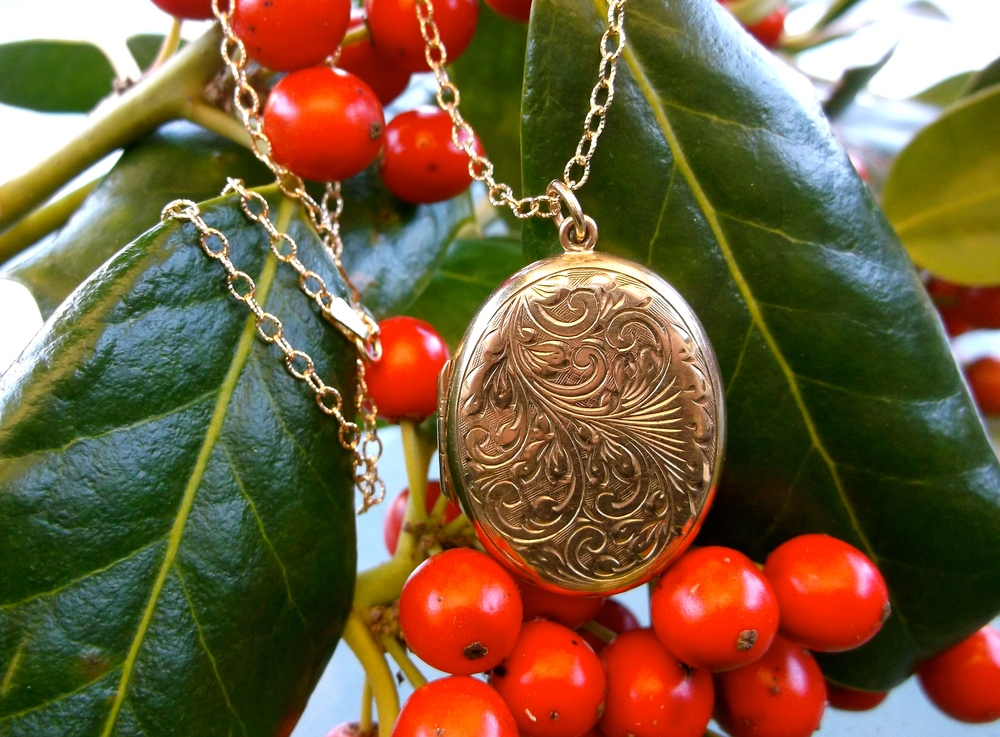 For December: An engraved gold locket (slightly bigger than a quarter).