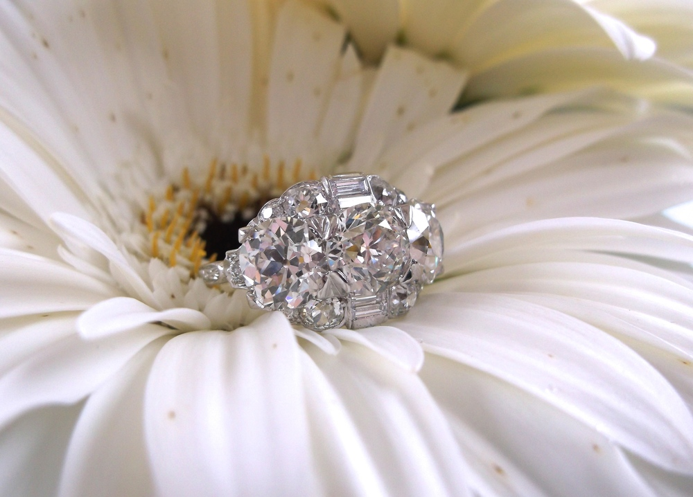 SOLD - Art Deco at its finest! 4.05 carats total weight in Old European cut diamonds set in platinum.