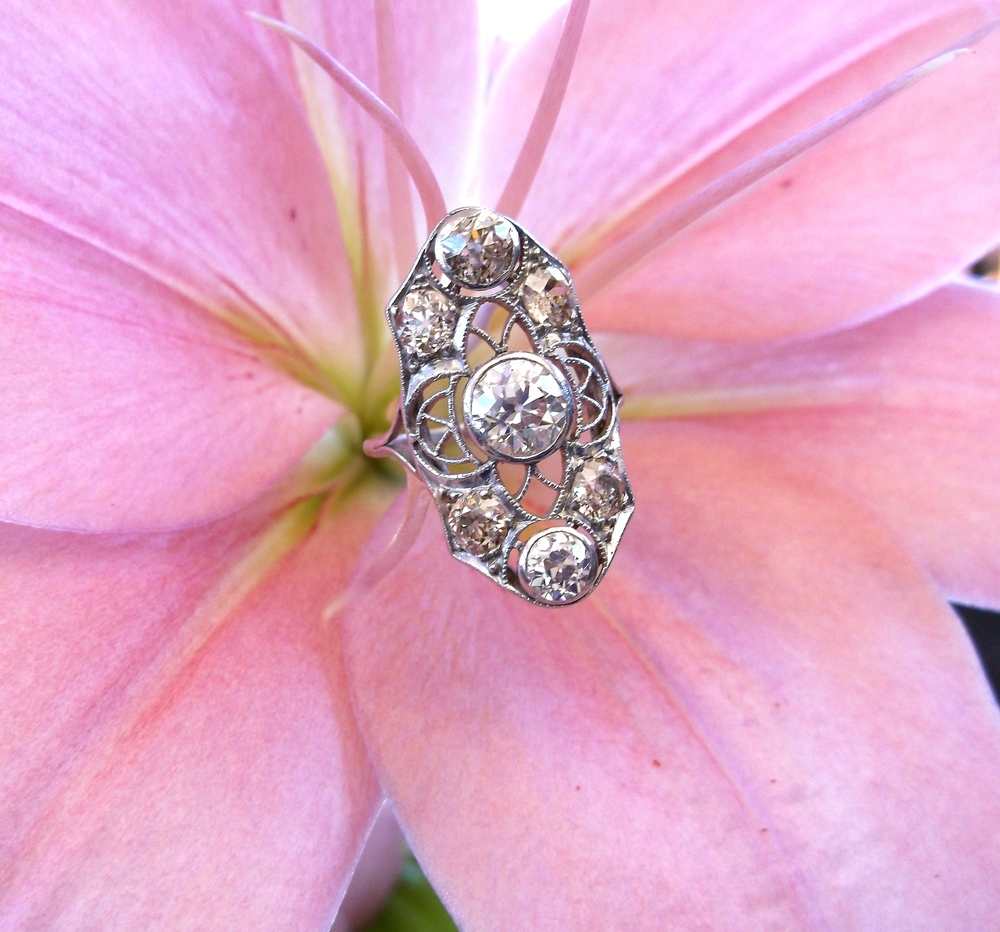"SOLD- Intricate Art Deco 0.90 carat center Old European cut diamond ring set in platinum with 2.00 carats total weight in Old European cut diamonds (approximately 1"" in length)."