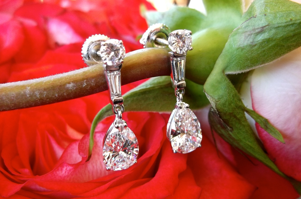 SOLD - Happy Valentine's Day! We are in love with this gorgeous pair of pear shaped diamond drop earrings featuring a 1.26 carat pear diamond dangling from each.