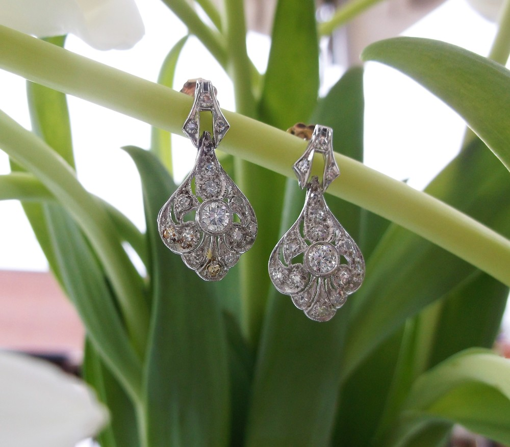 SOLD - Lovely diamond and platinum slight drop earrings with 1.00 carats total weight in diamonds.