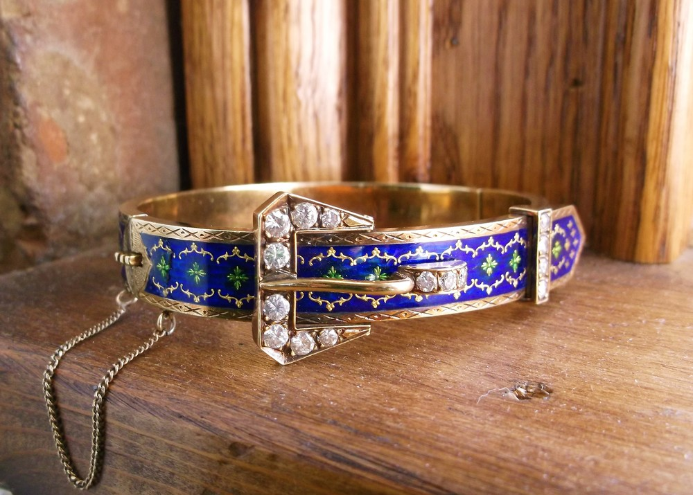 SOLD - Beautifully detailed 1940's European yellow gold buckle bracelet. The bracelet features gorgeous blue and green enameling paired with 1.00 carat total weight in diamonds.