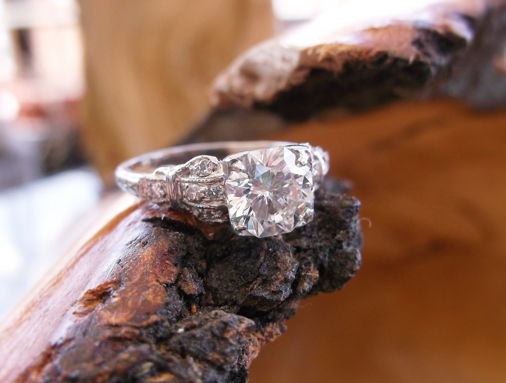 SOLD - Swoon worthy 1.32 carat center diamond in a platinum and diamond detail mounting.