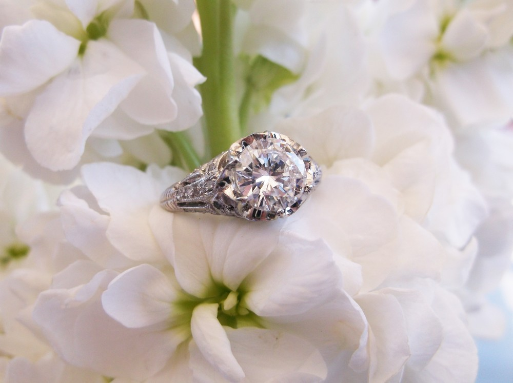 SOLD - Gorgeous 1.51 carat round brilliant cut diamond set in a beautiful diamond and platinum mounting.