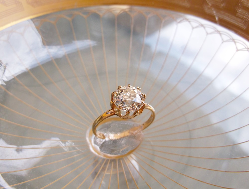 SOLD - Timeless late Victorian era 1.65 carat Old European cut diamond set in a dainty Victorian yellow gold ten prong mounting.