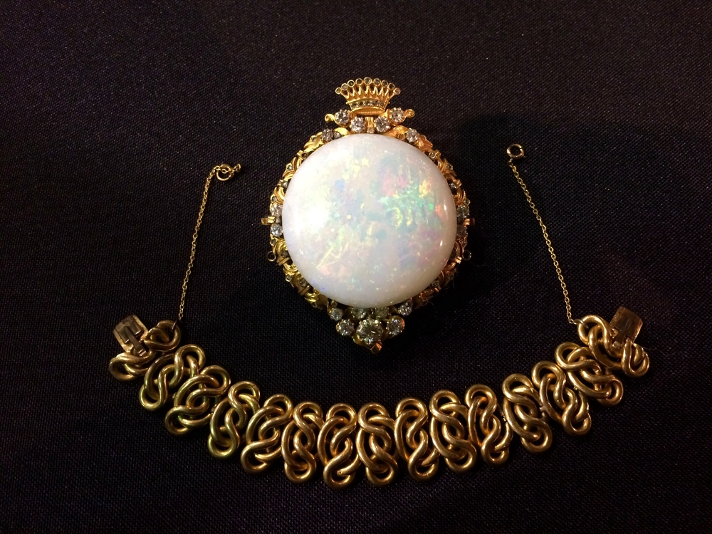 Victorian era gold, diamond and opal broach.  The bracelet portion can be locked into the sides of the broach to create a beautiful bracelet.