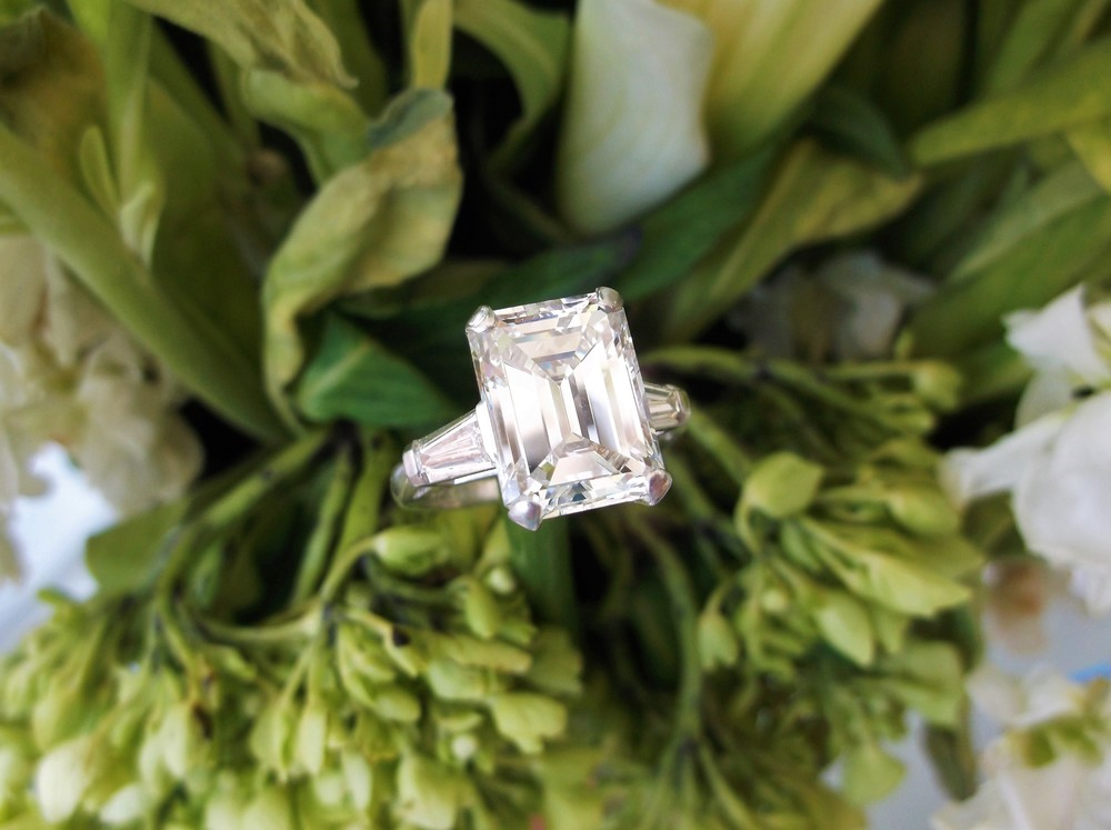 SOLD - Drop dead gorgeous 5.42 carat emerald cut diamond set in a classic baguette cut diamond and platinum mounting.