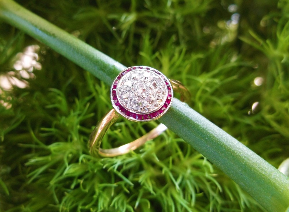 SOLD - Lovely Edwardian era, platinum topped gold, Old Mine cut diamond cluster ring surrounded by a halo of rubies (0.20 carats total weight in diamonds).