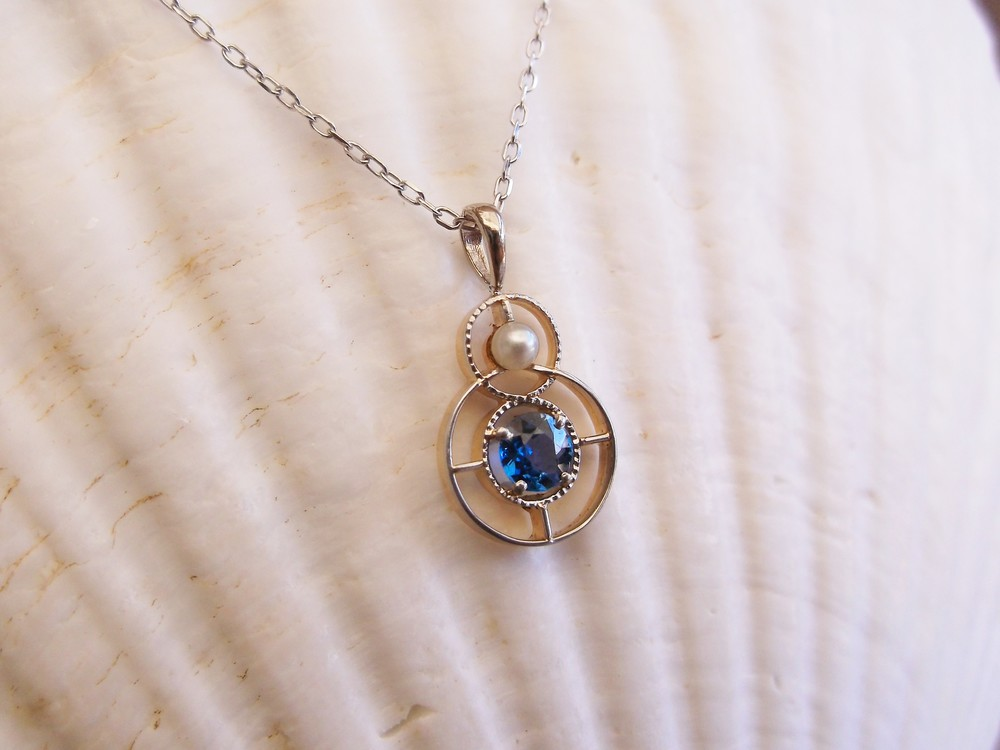 SOLD - Lovely Art Deco two tone gold, sapphire and pearl pendant on a dainty white gold chain.