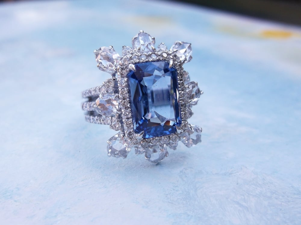 Beautiful 3.75 carat sapphire with approximately 2.00 carats total weight in rose cut and round brilliant cut diamonds set in 18K white gold.