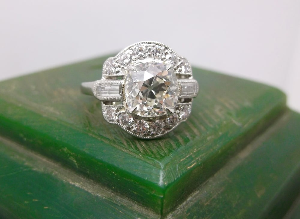 SOLD - Gorgeous 1920's 1.60 carat Old Mine cut diamond set in a beautfiul platinum and diamond mounting.