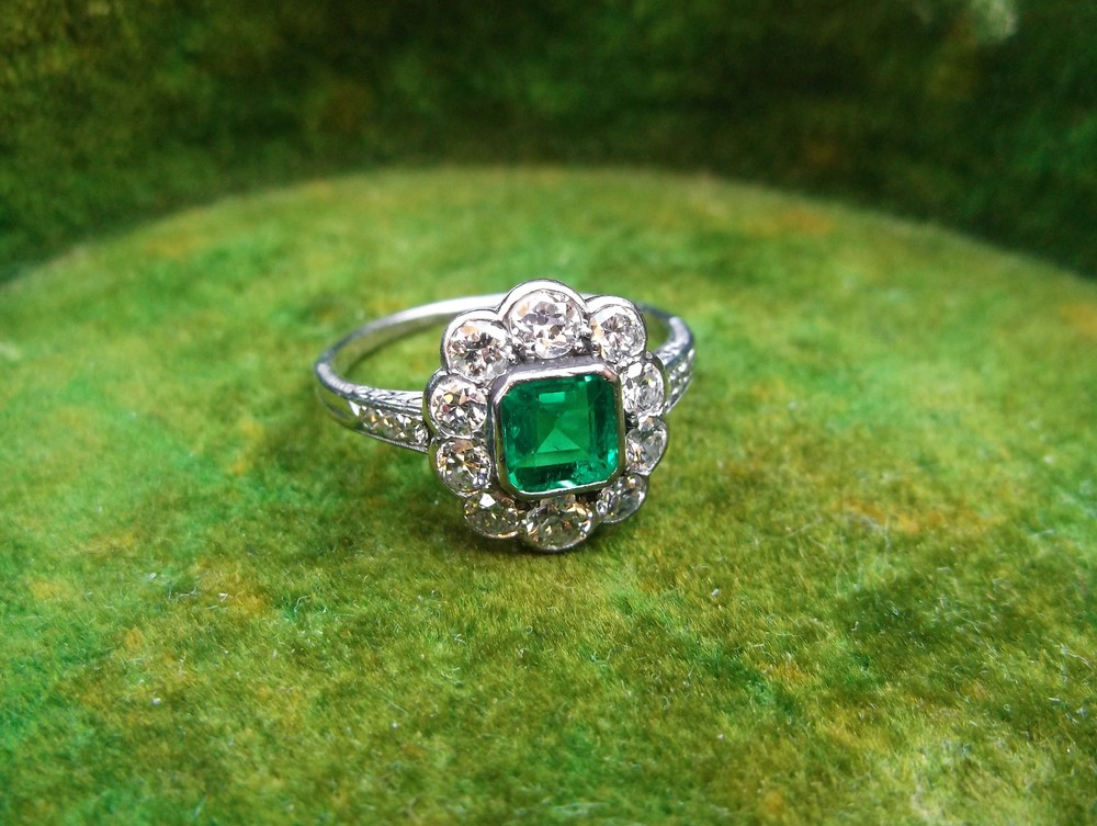 SOLD - Gorgeous 1920's 0.40 carat emerald surrounded by 0.75 carats total weight in Old European cut diamonds set in platinum.