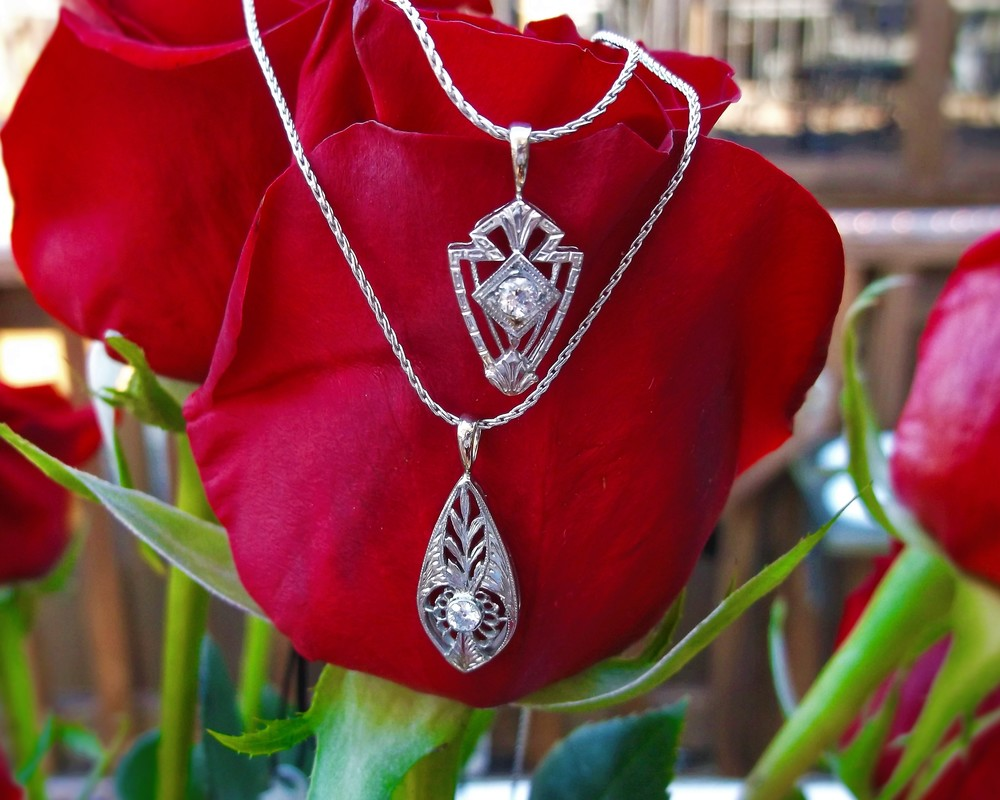 SOLD BOTH - Two lovely 1920's white gold and diamond pendants with beautiful filigree and engraving details. (And... both are under $500!)