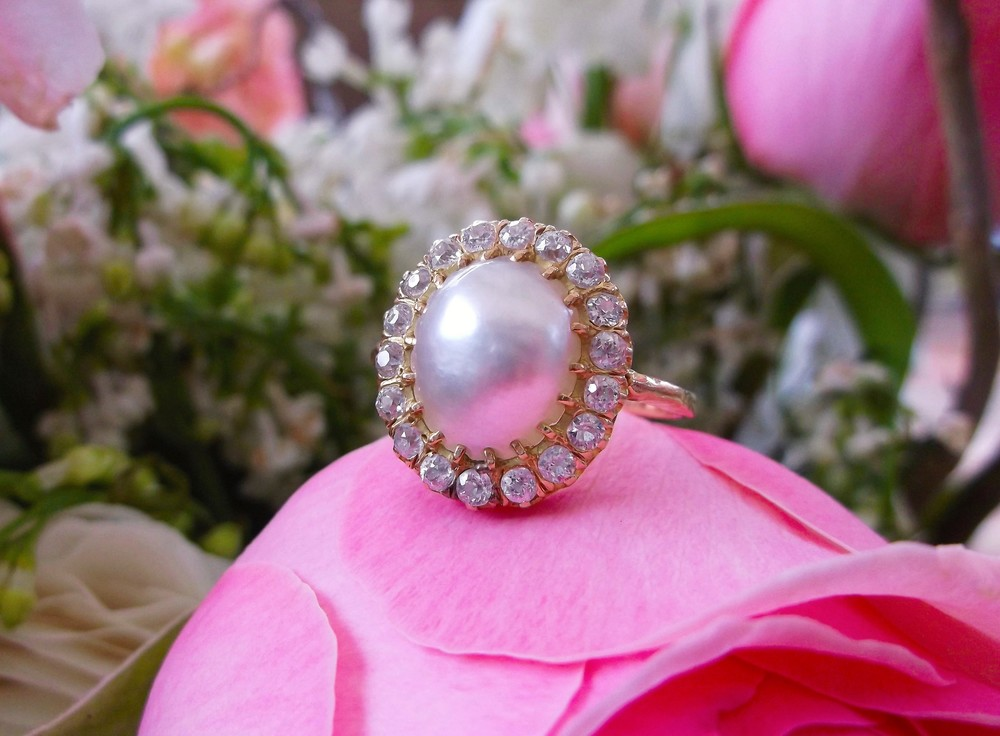 SOLD - Romantic, early 1900's mabe pearl and yellow gold ring with 0.75 carats total weight in Old Mine cut diamonds.