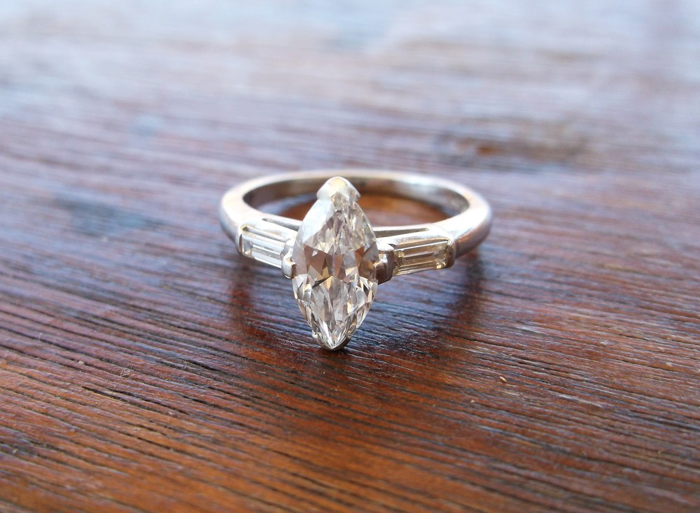 SOLD - Classic 1920's 0.93 carat marquis cut diamond with a baguette cut diamond on either side.