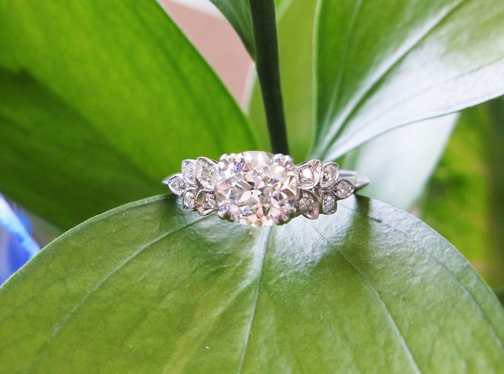 SOLD - Anticipating spring with this lovely 1.12 carat Old European cut diamond set in a leaf detail diamond and platinum mounting.