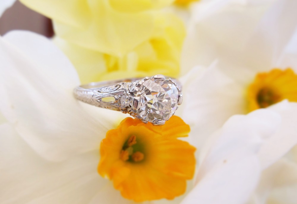 SOLD - Sophisticated 1920's 1.32 carat Old European cut diamond set in a platinum mounting with lovley diamond detail.