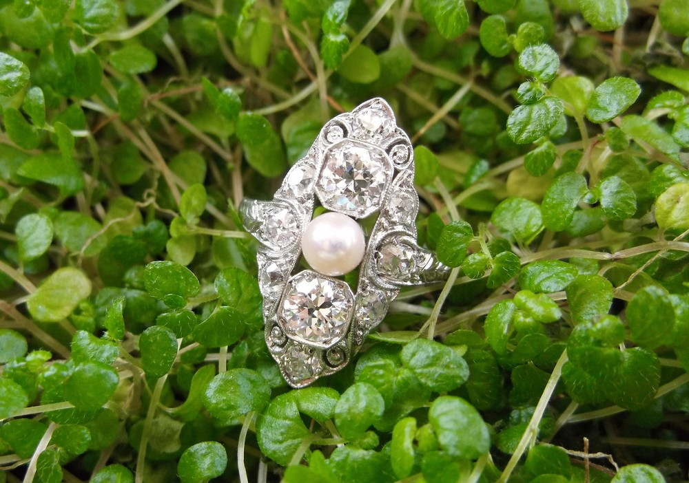 SOLD - Lovely 1920's Old European cut and Old Mine cut diamond ring set in platinum with a beautiful pearl in the center.