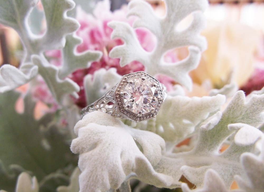 SOLD - Airy and refined 1.01 carat round brilliant cut diamond set in a beautiful filigree mounting.