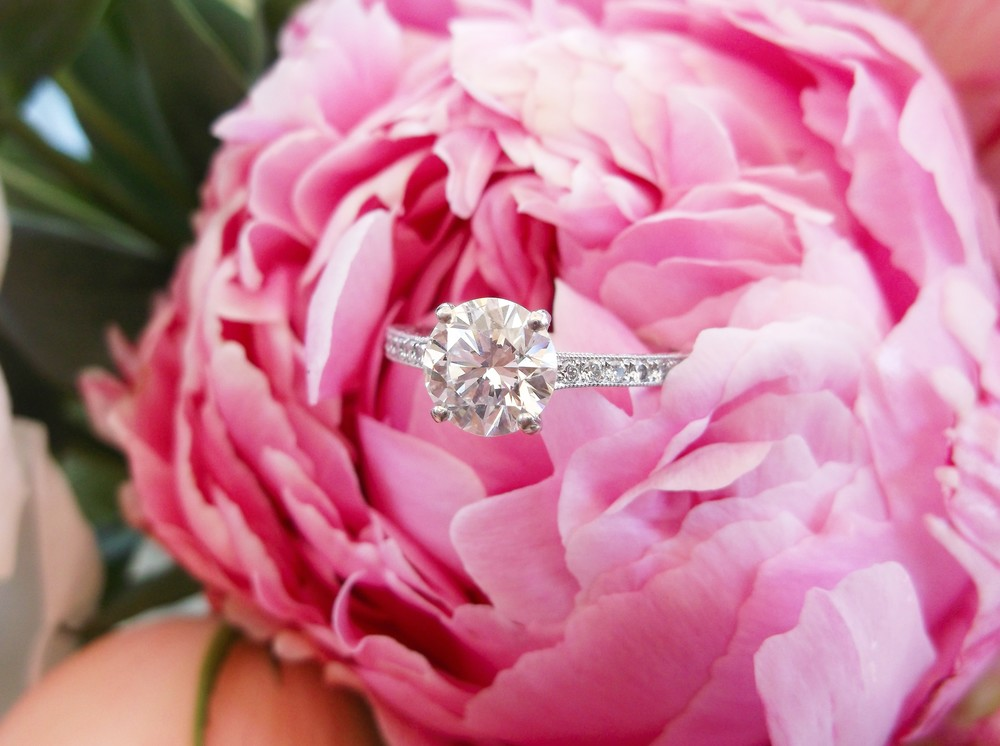 SOLD - This classic beauty features a 1.39 carat transitional cut diamond set in a lovely diamond and platinum mounting.