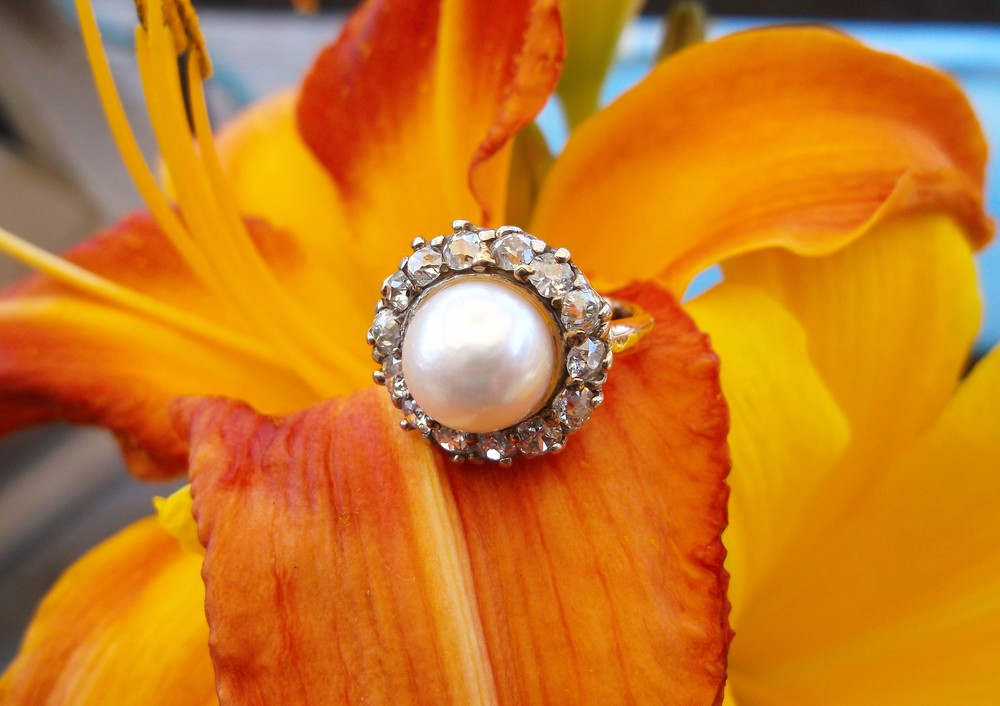 SOLD - Superb turn of century, platinum topped gold, pearl ring surrounded by 1.25 carats total weight in Old Mine cut diamonds.