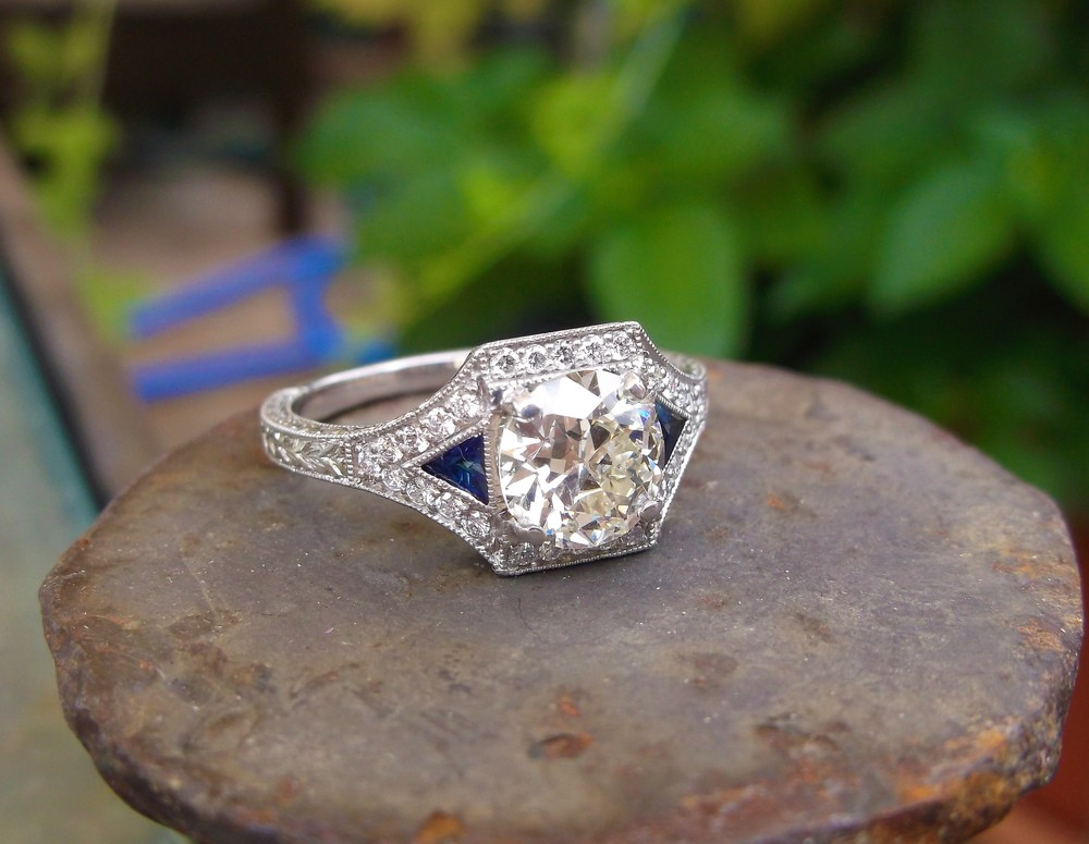 SOLD - Gorgeous 1.23 carat Old European cut diamond set in a beautiful diamond, sapphire and platinum mounting.
