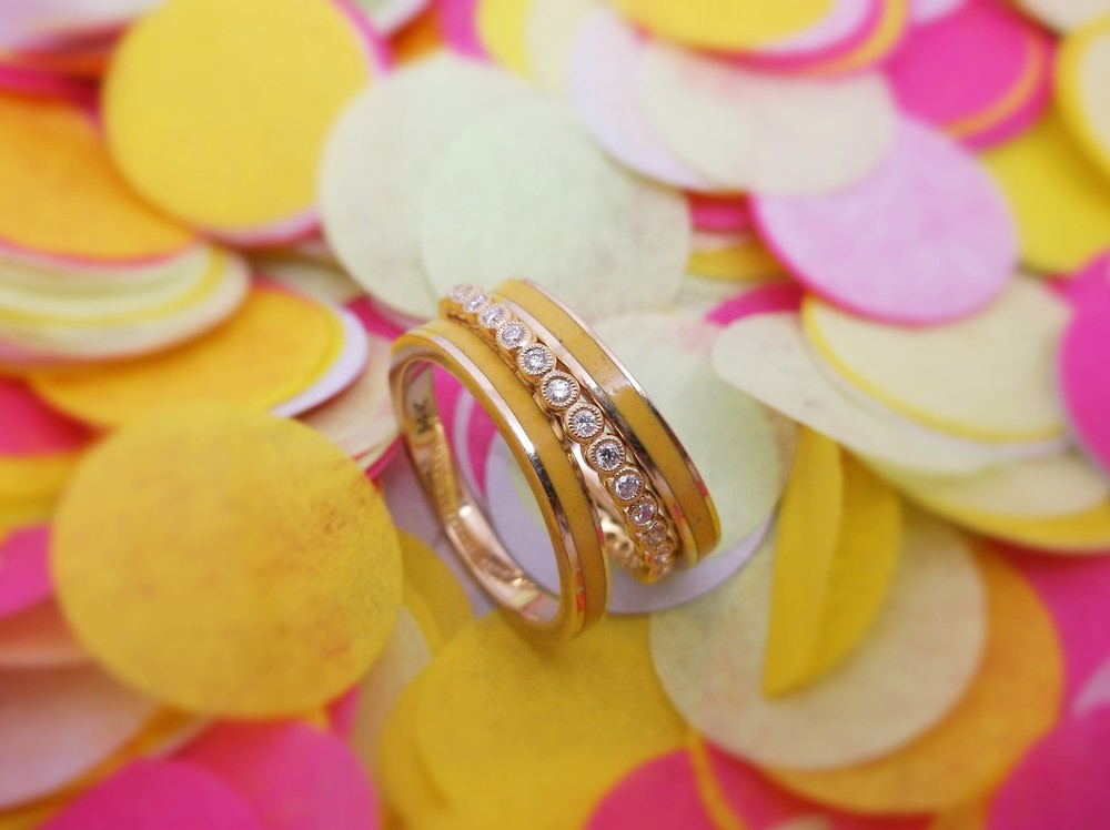 Playful yellow gold and yellow enamel bands paired with a sweet yellow gold diamond eternity band.