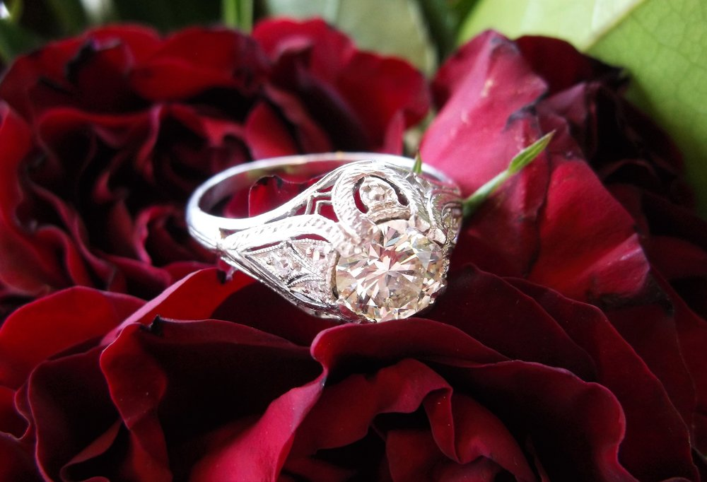 SOLD - Enchanting 1.09 carat diamond set in a lovely filigree and diamond detail mounting.