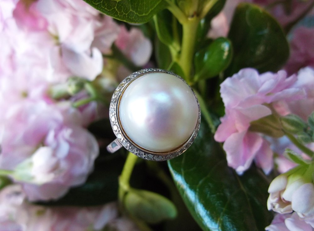 SOLD - Gorgeous 15.0 mm South Sea pearl set in a lovely diamond and platinum mounting.