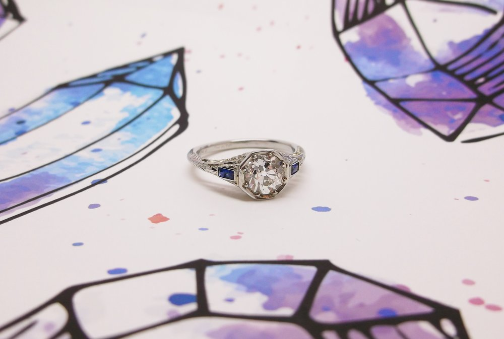 SOLD - Crystalline 1.17 carat Old European cut diamond set in a sapphire and white gold detail mounting.