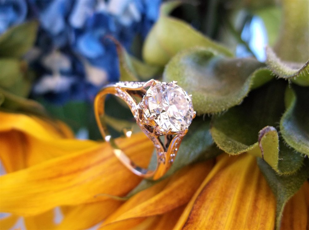 Gorgeous 1.79 carat transitional cut diamond set in a diamond and yellow gold mounting.