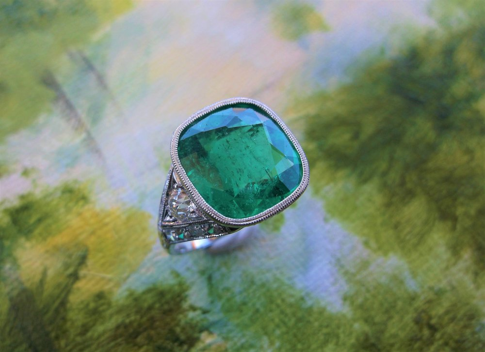 SOLD - Absolutely stunning 5.13 carat emerald set in a hand engraved milgrain bezel setting with Old Mine cut and single cut diamond details.