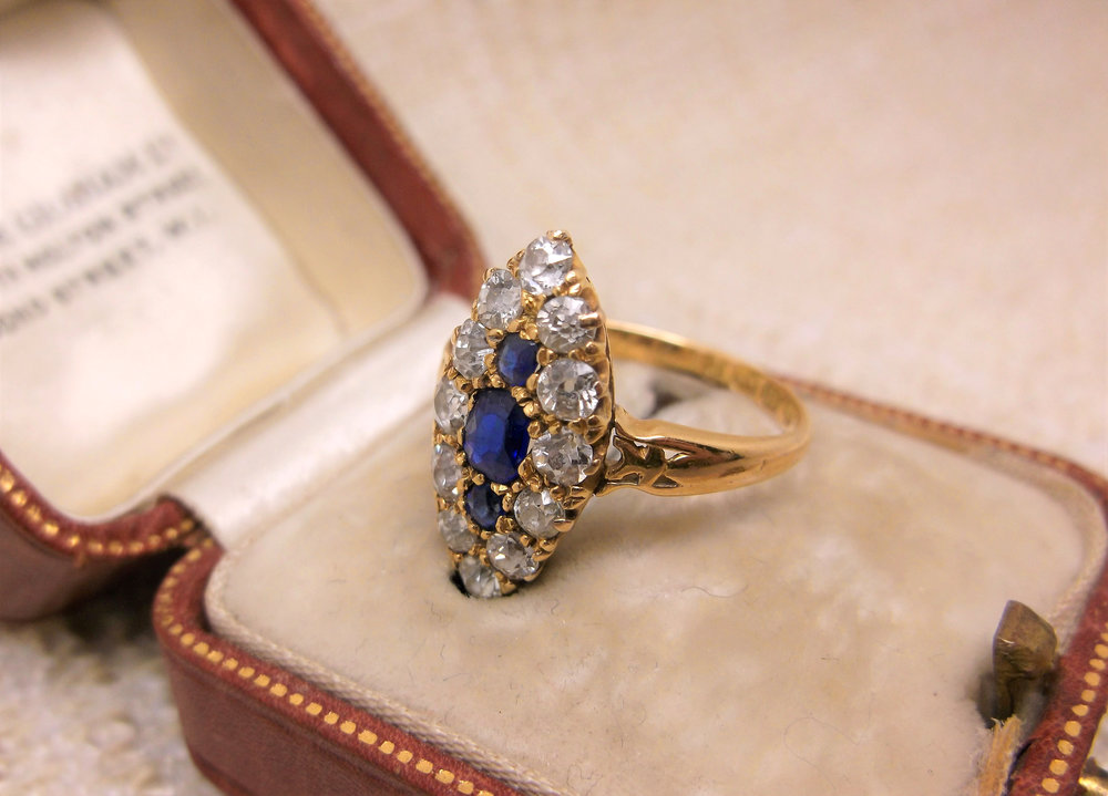 "SOLD - ""Amor Omnia Vincit"" or ""Love Conquers All"" is beautifully inscribed in this 18K yellow gold, sapphire and Old Mine cut diamond navette ring from the year 1900."
