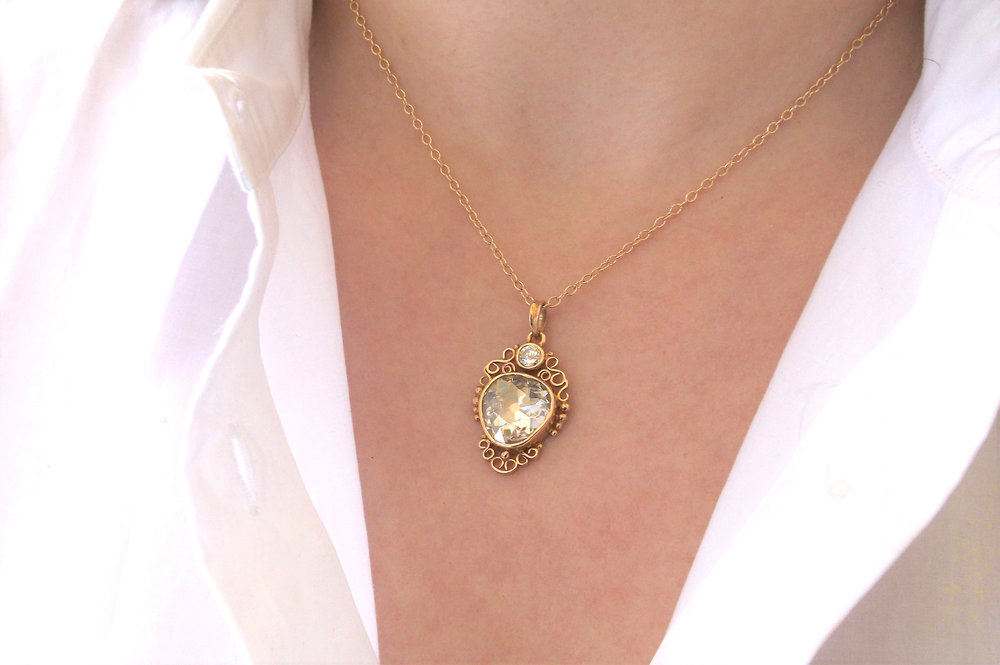 Mesmerizing 5.00 carat Old European cut diamond set in a lovely yellow gold pendant with a 0.33 carat diamond set at the top. Shop this pendant  HERE