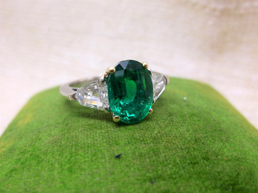 Pinch proof yourself this St. Patrick's Day with this jaw dropping 2.93 carat emerald ring with two gorgeous trapezoid cut diamonds on each side. Shop this ring  HERE