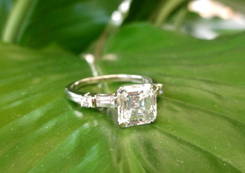 SOLD - Gorgeous 2.54 carat asscher cut diamond ring with beautiful baguette and round cut diamond details.